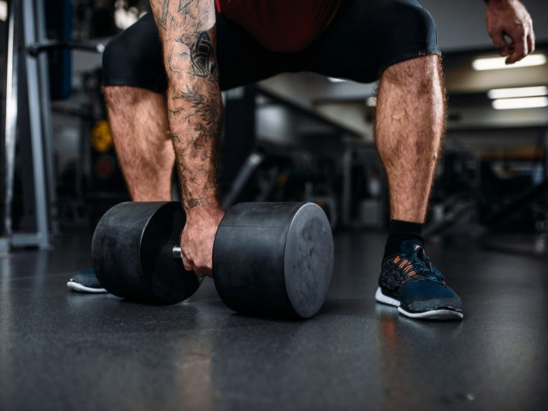 male-person-with-dumbbell-training-in-gym-37LACSK-min