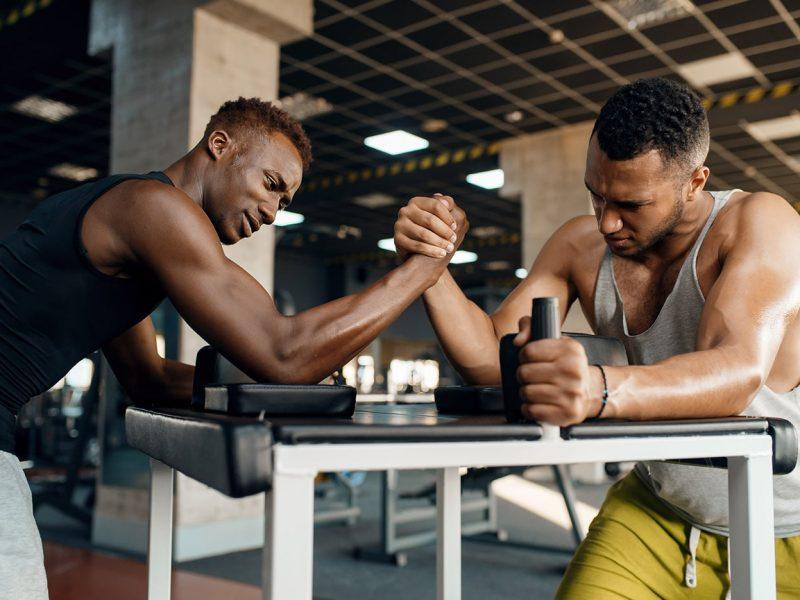 two-men-fighting-arm-wrestling-training-in-gym-CQ468DL-min