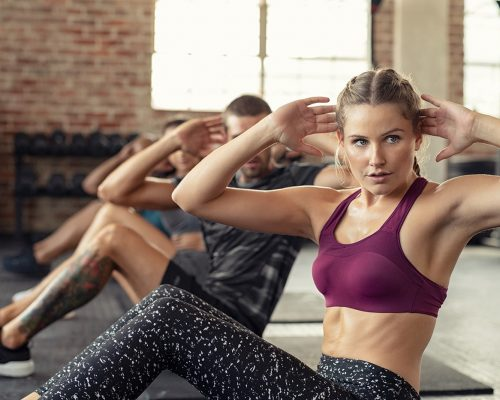 woman-doing-abs-exercise-at-cardio-course-PLQKSM2-min